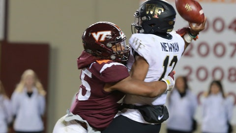 <p>               Virginia Tech defensive lineman TyJuan Garbutt (45) knocks the ball loose as Wake Forest quarterback Jamie Newman (12) attempts a pass during the second half of an NCAA college football game in Blacksburg, Va., Saturday, Nov. 9, 2019. Virginia Tech defeated Wake Forest 36-17. (AP Photo/Steve Helber)             </p>