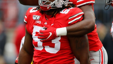 <p>               Ohio State defensive lineman Davon Hamilton, front, celebrates his sack against Maryland with teammate running back Zach Harrison during the first half of an NCAA college football game, Saturday, Nov. 9, 2019, in Columbus, Ohio. (AP Photo/Jay LaPrete)             </p>