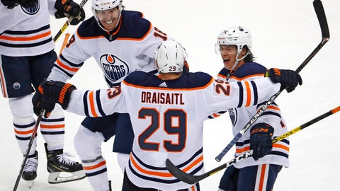 <p>               Edmonton Oilers' Leon Draisaitl (29) celebrates his game-winning goal, with James Neal (18) and Ethan Bear, right, during the overtime period of an NHL hockey game against the Pittsburgh Penguins in Pittsburgh, Saturday, Nov. 2, 2019. The Oilers won 2-1. (AP Photo/Gene J. Puskar)             </p>