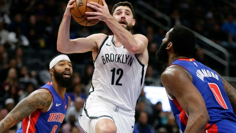 <p>               Brooklyn Nets forward Joe Harris (12) drives to the basket against Detroit Pistons forward Markieff Morris (8) and center Andre Drummond (0) during the first half of an NBA basketball game Saturday, Nov. 2, 2019, in Detroit. (AP Photo/Duane Burleson)             </p>