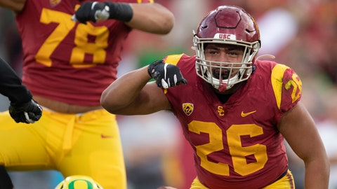 <p>               Southern California linebacker Kana'i Mauga, right, celebrates his sack against Oregon during the first half of an NCAA college football game Saturday, Nov. 2, 2019, in Los Angeles. (AP Photo/Kyusung Gong)             </p>