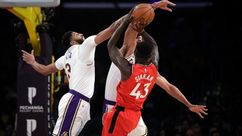 <p>               Los Angeles Lakers' Anthony Davis, left, blocks a shot from Toronto Raptors' Pascal Siakam (43) during the first half of an NBA basketball game Sunday, Nov. 10, 2019, in Los Angeles. (AP Photo/Marcio Jose Sanchez)             </p>
