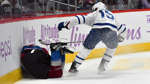 <p>               Toronto Maple Leafs center Alexander Kerfoot (15) gets penalized for boarding on Colorado Avalanche defenseman Erik Johnson (6) as he lays on the ice against the boards in an NHL hockey game Saturday, Nov. 23, 2019 in Denver. (AP Photo/John Leyba)             </p>