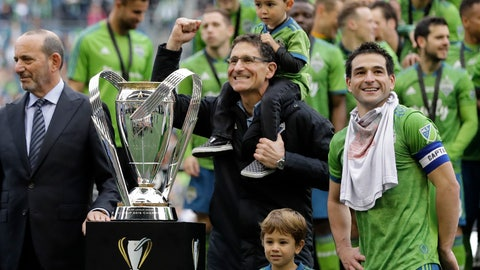 <p>               Seattle Sounders owner Adrian Hanauer, center, celebrates beside MLS commissioner Don Garber, left, and player Nicolas Lodeiro, right, after the Sounders defeated Toronto FC, Sunday, Nov. 10, 2019, in the MLS Cup championship soccer match in Seattle. The Sounders won 3-1. (AP Photo/Ted S. Warren)             </p>
