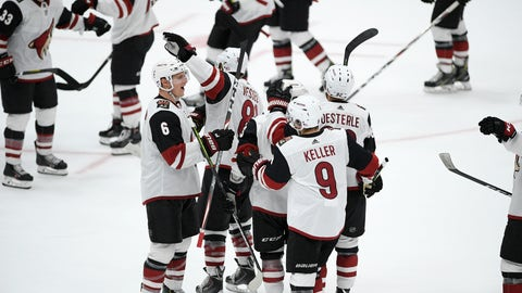<p>               The Arizona Coyotes celebrate after they won an NHL hockey game against the Washington Capitals, Monday, Nov. 11, 2019, in Washington. The Coyotes won 4-3 after a shootout. (AP Photo/Nick Wass)             </p>
