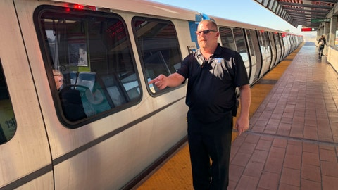 <p>               In this photo taken Monday, Nov. 4, 2019, transit supervisor John O'Connor talks with reporters about pulling a man from the tracks in front of a coming train at the Bay Area Rapid Transit Coliseum station in Oakland, Calif. O'Connor was hailed as a hero for pulling a drunken man from the tracks an instate before a train sped into the station. The Bay Area Rapid Transit released surveillance video showing supervisor O'Connor spring to action Sunday after a man fell onto the tracks.   (AP Photo/Terry Chea)             </p>