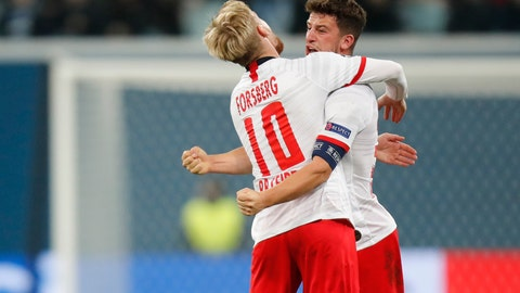 <p>               Leipzig's Diego Demme, right, celebrates with teammate Leipzig's Emil Forsberg after scoring the opening goal during the Champions League group G soccer match between Zenit St. Petersburg and RB Leipzig at the Saint Petersburg stadium in St.Petersburg, Russia, Tuesday, Nov. 5, 2019. (AP Photo/Dmitri Lovetsky)             </p>