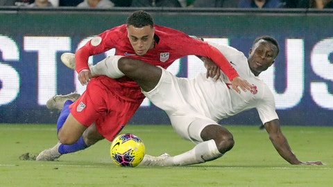 <p>               U.S. defender Sergino Dest, left, gets tangled up with Canada defender Richie Laryea while going after the ball during the first half of a CONCACAF Nations League soccer match Friday, Nov. 15, 2019, in Orlando, Fla. (AP Photo/John Raoux)             </p>