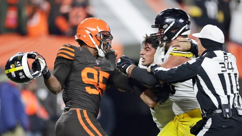 <p>               Cleveland Browns defensive end Myles Garrett, left, gets ready to hit Pittsburgh Steelers quarterback Mason Rudolph, second from left, with a helmet during the second half of an NFL football game Thursday, Nov. 14, 2019, in Cleveland. The Browns won 21-7. (AP Photo/Ron Schwane)             </p>