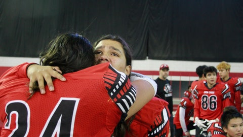 <p>               In this Nov. 8, 2019 photo, Jashawn Pease, right, embraces his brother Jayton, as they celebrate their 74-39 victory in the All Nations Football Conference championship in Vermillion, S.D.  Jashawn and Jayton Pease shed tears as the Crow Creek Chieftains won the first All Nations Conference championship, and then remembered their older brother _ one of too many American Indians to die by suicide on a reservation with the highest suicide rate in South Dakota. (AP Photo/Stephen Groves)             </p>