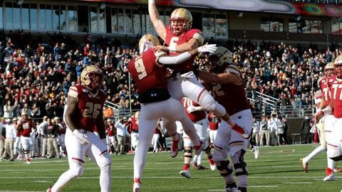 <p>               Boston College quarterback Dennis Grosel, top, celebrates his touchdown pass to wide receiver Kobay White (9) in the first half of an NCAA college football game against Florida State, Saturday, Nov. 9, 2019, in Boston. (AP Photo/Bill Sikes)             </p>