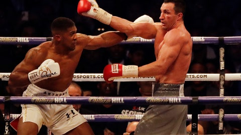 <p>               FILE - In this Saturday, April 29, 2017 file photo, British boxer Anthony Joshua, left, fights Ukrainian boxer Wladimir Klitschko for Joshua's IBF and the vacant WBA Super World and IBO heavyweight titles at Wembley stadium in London. Joshua won with an 11th round stoppage. Former heavyweight boxing champion turned philanthropist and management thinker Wladimir Klitschko praises his home country of Ukraine in a year when it has had a starring role in politics and on television in the United States. (AP Photo/Matt Dunham, File)             </p>