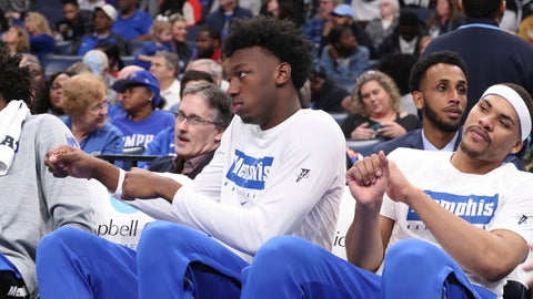 <p>               Memphis' James Wiseman, second from right, sits out the game along with Isaiah Stokes, right, in an NCAA college basketball game against Alcorn State Saturday, Nov. 16, 2019, in Memphis, Tenn. Malcolm Dandridge is first from right. (AP Photo/Karen Pulfer Focht)             </p>