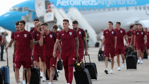 <p>               Argentina's River Plate soccer team walks on the airport tarmac after arriving to the military airport Grupo Aereo 8, in Lima, Peru, Wednesday, Nov. 20, 2019. The team will play Brazil's Flamengo on Saturday's Copa Libertadores final. (AP Photo/Martin Mejia)             </p>