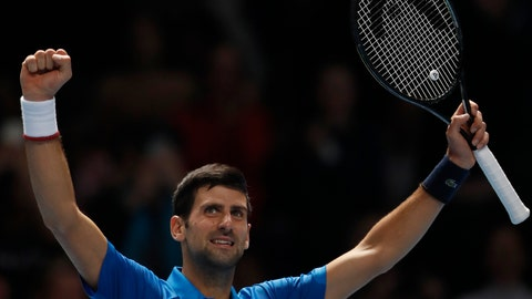 <p>               Serbia's Novak Djokovic celebrates after defeating Italy's Matteo Berrettini in their ATP World Tour Finals singles tennis match at the O2 Arena in London, Sunday, Nov. 10, 2019. (AP Photo/Alastair Grant)             </p>