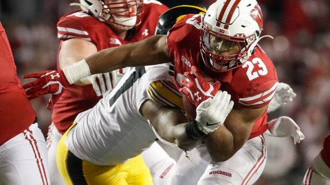 <p>               Wisconsin's Jonathan Taylor runs during the second half of an NCAA college football game against Iowa Saturday, Nov. 9, 2019, in Madison, Wis. Wisconsin won 24-22. (AP Photo/Morry Gash)             </p>