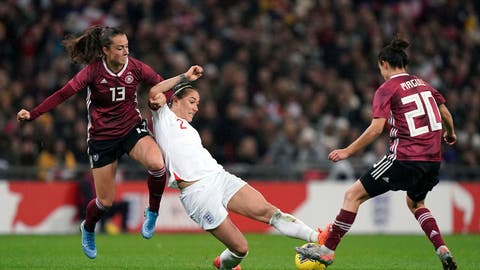 <p>               Germany's Sara Dabritz, left and Lina Magull, right, battle for the ball with England's Lucy Bronze , during the Women's International Friendly soccer match between England and Germany, at Wembley Stadium, in London, Saturday, Nov. 9, 2019. (John Walton/PA via AP)             </p>