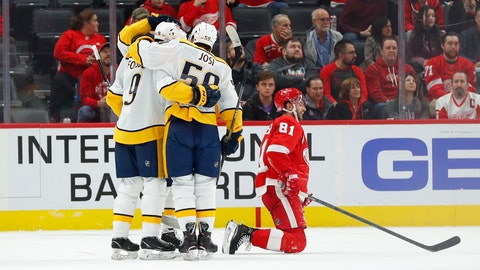 <p>               Nashville Predators center Matt Duchene (obscured) celebrates his goal with Filip Forsberg (9) and Roman Josi (59) as Detroit Red Wings center Frans Nielsen (81) kneels on the ice in the second period of an NHL hockey game Monday, Nov. 4, 2019, in Detroit. (AP Photo/Paul Sancya)             </p>