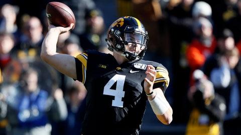 <p>               Iowa quarterback Nate Stanley throws a pass during the first half of an NCAA college football game against Illinois, Saturday, Nov. 23, 2019, in Iowa City, Iowa. Iowa won 19-10. (AP Photo/Charlie Neibergall)             </p>