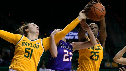 <p>               Baylor forward Caitlin Bickle (51) and center Queen Egbo (25) compete against Houston forward Lauren Calver, center, for a rebound during the second half of an NCAA college basketball game in Waco, Texas, Thursday, Nov. 14, 2019. (AP Photo/Tony Gutierrez)             </p>