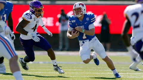 <p>               SMU quarterback Shane Buechele (7) looks for room to run while East Carolina cornerback Malik Fleming (4) gives chase during the first half of an NCAA college football game, Saturday, Nov. 9, 2019, in Dallas. (AP Photo/Roger Steinman)             </p>