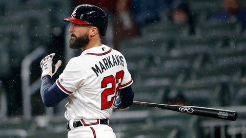 <p>               FILE - In this April 4, 2019, file photo, Atlanta Braves' Nick Markakis follows through on a three-run double in the fifth inning of baseball game against the Chicago Cubs in Atlanta. The  Braves have re-signed outfielder Markakis and catcher Tyler Flowers to $4 million, one-year contracts for 2020 after declining their $6 million team options, which triggered $2 million buyout. (AP Photo/John Bazemore, File)             </p>