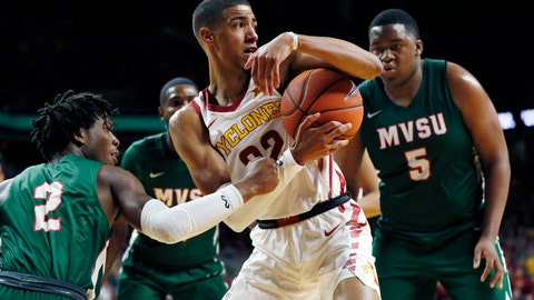 <p>               Iowa State guard Tyrese Haliburton, center, grabs a rebound between Mississippi Valley State's Brandon Kimble, left, and Richard Rivers Jr., right, during the first half of an NCAA college basketball game, Tuesday, Nov. 5, 2019, in Ames, Iowa. (AP Photo/Charlie Neibergall)             </p>