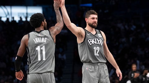 <p>               Brooklyn Nets guard Kyrie Irving (11) and forward Joe Harris (12) celebrate as they come into the bench during a timeout in the final moments of the second half of an NBA basketball game against the New Orleans Pelicans, Monday, Nov. 4, 2019, in New York. (AP Photo/Mary Altaffer)             </p>