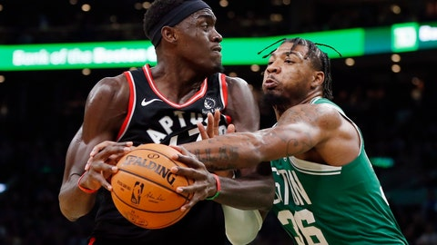 <p>               Boston Celtics' Marcus Smart (36) defends against Toronto Raptors' Pascal Siakam during the second half of an NBA basketball game in Boston, Friday, Oct. 25, 2019. (AP Photo/Michael Dwyer)             </p>