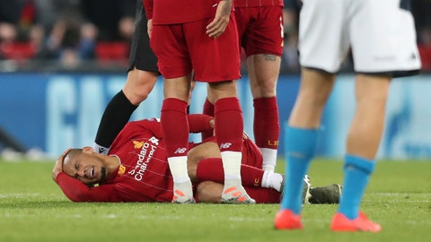 <p>               Liverpool's Fabinho lies injured before leaving the game during the Champions League Group E soccer match between Liverpool and Napoli at Anfield stadium in Liverpool, England, Wednesday, Nov. 27, 2019. (AP Photo/Jon Super)             </p>