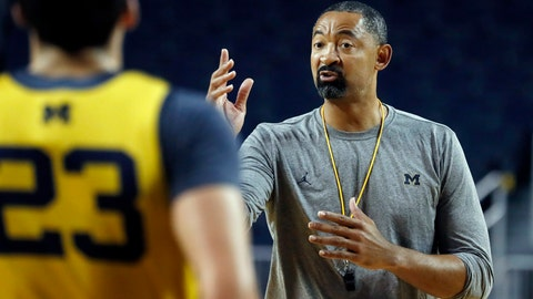 <p>               FILE - In this Thursday, Oct. 17, 2019, file photo, Michigan head coach Juwan Howard directs his team during NCAA college basketball practice in Ann Arbor, Mich. Howard took over his former team when he replaced John Beilein at Michigan. (AP Photo/Carlos Osorio, File)             </p>