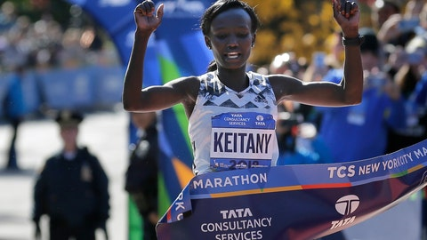 <p>               FILE - In this Nov. 4, 2018, file photo, Mary Keitany, of Kenya, crosses the finish line to win the women's division of the New York City Marathon in New York. Keitany is back for another bolt through the boroughs. Facing a thin field, she's eyeing another first-place finish.(AP Photo/Seth Wenig, File)             </p>