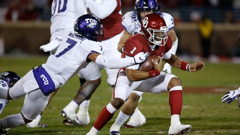 <p>               Oklahoma quarterback Jalen Hurts (1) carries past TCU safety Trevon Moehrig (7) and linebacker Garret Wallow (30) in the first quarter of an NCAA college football game in Norman, Okla., Saturday, Nov. 23, 2019. (AP Photo/Sue Ogrocki)             </p>