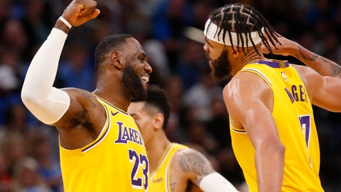 <p>               Los Angeles Lakers forward LeBron James (23) celebrates with center JaVale McGee (7) during a timeout in the second half of the team's NBA basketball game against the Oklahoma City Thunder on Friday, Nov. 22, 2019, in Oklahoma City. (AP Photo/Sue Ogrocki)             </p>