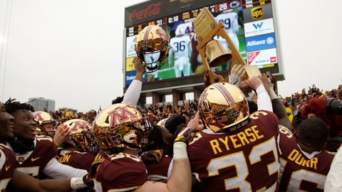<p>               Minnesota football players hold up the Governor's Victory Bell after winning 31-26 against Penn State during an NCAA college football game Saturday, Nov. 9, 2019, in Minneapolis. (AP Photo/Stacy Bengs)             </p>