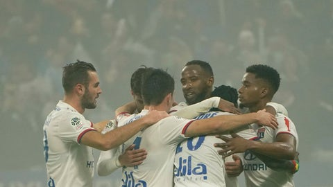 <p>               Lyon's Moussa Dembele his teammates, celebrates his goal against Nice during the French League One soccer match between Lyon and Nice, at Groupama stadium in Decines, near Lyon, central France, Saturday, Nov. 23, 2019. (AP Photo/Laurent Cipriani)             </p>