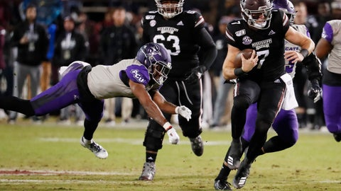 <p>               Mississippi State quarterback Tommy Stevens (7) evades an Abilene Christian defender as he runs for short yardage during the first half of an NCAA college football game, Saturday, Nov. 23, 2019, in Starkville, Miss. (AP Photo/Rogelio V. Solis)             </p>