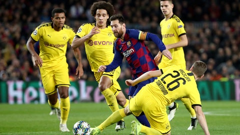 <p>               Barcelona's Lionel Messi drives the ball past Dortmund's Lukasz Piszczek, right, during a Champions League group F soccer match between Barcelona and Dortmund at the Camp Nou stadium in Barcelona, Spain, Wednesday, Nov. 27, 2019. (AP Photo/Emilio Morenatti)             </p>