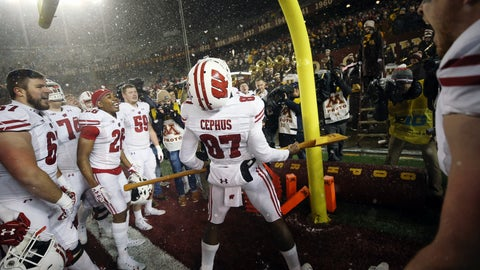 <p>               Wisconsin wide receiver Quintez Cephus (87) holds Paul Bunyan's Axe in celebration after Wisconsin beat Minnesota 38-17 in an NCAA college football game Saturday, Nov. 30, 2019, in Minneapolis. (AP Photo/Stacy Bengs)             </p>