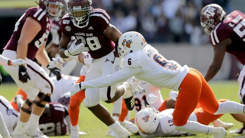<p>               Texas A&M running back Isaiah Spiller (28) brushes off a tackle by UTSA safety SaVion Harris (6) for a first down run during the first quarter of an NCAA college football game, Saturday, Nov. 2, 2019, in College Station, Texas. (AP Photo/Sam Craft)             </p>