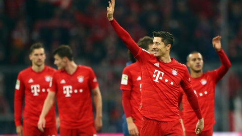 <p>               Bayern's Robert Lewandowski, front right, waves to supporters at the end of the German Bundesliga soccer match between FC Bayern Munich and Borussia Dortmund, in Munich, Germany, Saturday, Nov. 9, 2019. (AP Photo/Matthias Schrader)             </p>