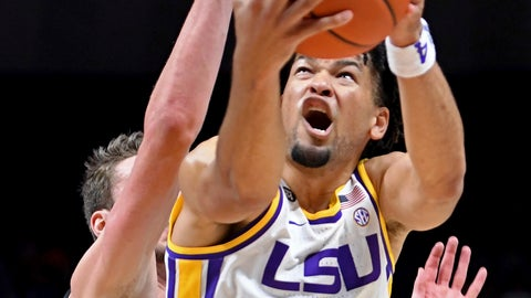 <p>               LSU guard Skylar Mays (4) grimaces while driving to the basket past UMBC guard Brandon Horvath during the first half of an NCAA college basketball game Tuesday, Nov. 19, 2019, in Baton Rouge, La. (AP Photo/Bill Feig)             </p>