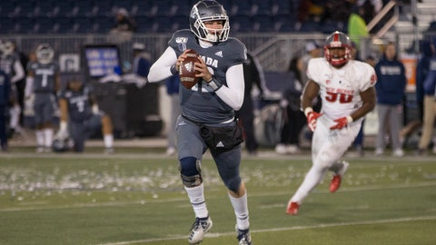 <p>               Nevada quarterback Carson Strong (12 ) rolls out against New Mexico second half of an NCAA college football game in Reno, Nev., Saturday, Nov. 2, 2019. (AP Photo/Tom R. Smedes)             </p>