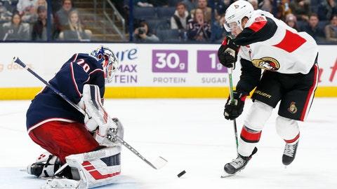 <p>               Columbus Blue Jackets' Joonas Korpisalo, left, of Finland, makes a save against Ottawa Senators' Connor Brown during the third period of an NHL hockey game Monday, Nov. 25, 2019, in Columbus, Ohio. The Blue Jackets beat the Senators 1-0. (AP Photo/Jay LaPrete)             </p>