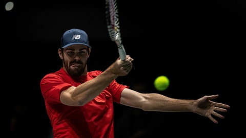 <p>               USA player Reilly Opelka returns the ball to Canada's Vasek Pospisil during their Davis Cup tennis match in Madrid, Spain, Tuesday, Nov. 19, 2019. (AP Photo/Bernat Armangue)             </p>