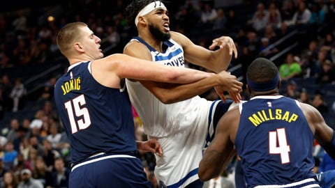 <p>               Denver Nuggets' Nikola Jokic, left, of Serbia, knocks the ball away from Minnesota Timberwolves' Karl-Anthony Towns in the first half of an NBA basketball game Sunday, Nov 10, 2019, in Minneapolis. (AP Photo/Jim Mone)             </p>
