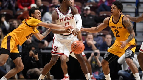<p>               Arizona State's Jaelen House, left, knocks the ball from St. John's Mustapha Heron, center, as Arizona State's Rob Edwards, right, defends during the first half of an NCAA college basketball game, Saturday, Nov. 23, 2019, in Uncasville, Conn. (AP Photo/Jessica Hill)             </p>