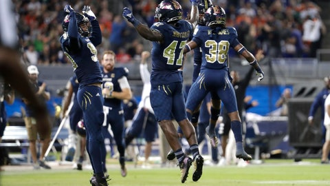 <p>               FIU defensive lineman Noah Curtis, left, and linebacker Chris Whittaker (47) celebrate after their team stopped Miami on fourth down during the first half of an NCAA college football game, Saturday, Nov. 23, 2019, in Miami. (AP Photo/Lynne Sladky)             </p>