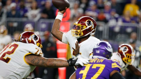 <p>               Washington Redskins quarterback Dwayne Haskins, center, throws a pass during the second half of an NFL football game against the Minnesota Vikings, Thursday, Oct. 24, 2019, in Minneapolis. (AP Photo/Bruce Kluckhohn)             </p>