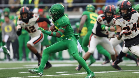 <p>               Oregon cornerback Mykael Wright (2) runs the ball to score a touchdown off a 98-yard kickoff return during the first half of an NCAA college football game against Oregon State in Eugene, Ore., Saturday, Nov. 30, 2019. (AP Photo/Amanda Loman)             </p>
